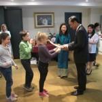 Receiving souvenirs from Ambassador Apichart
