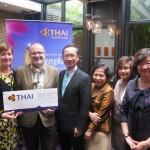 Presentation of the Thai Airways roundtrip Brussels-Bangkok airticket to Richard Werly